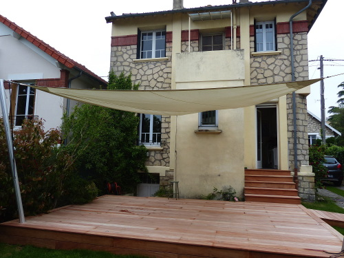 Voile d'ombre triangulaire pour ma terrasse
